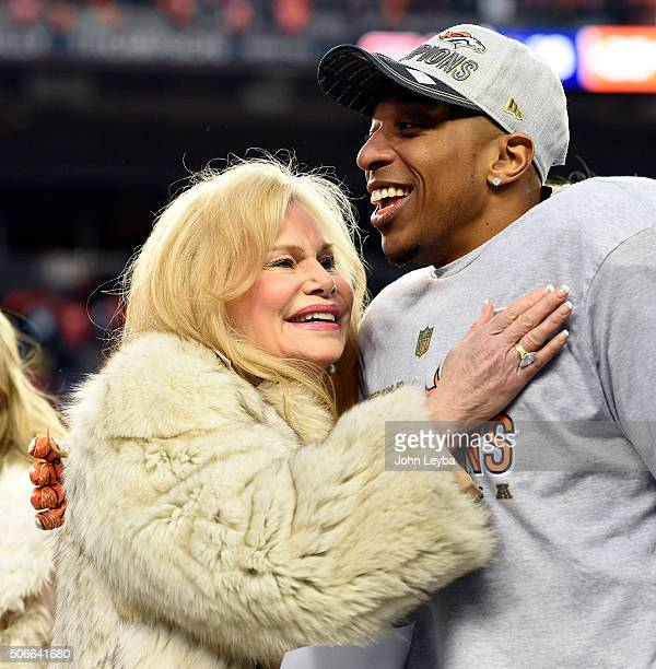 Cornerback Chris Harris Jr of the Denver Broncos gets a hug from Annabel Bowlen wife of Pat Bowlen after the Broncos defeated the Patriots 20 to 18...