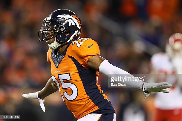 Cornerback Chris Harris of the Denver Broncos celebrates after a play in the first quarter of the game against the Kansas City Chiefs at Sports...