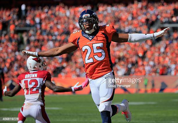 Cornerback Chris Harris of the Denver Broncos celebrates after breaking up a pass intended for wide receiver John Brown of the Arizona Cardinals at...