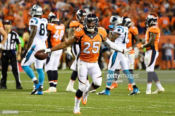 Cornerback Chris Harris of the Denver Broncos celebrates his interception off of quarterback Cam Newton of the Carolina Panthers during the fourth...