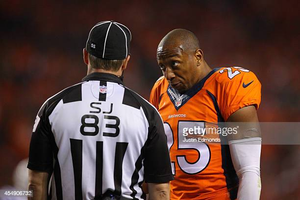 Cornerback Chris Harris of the Denver Broncos has a word with a referee during a game against the Indianapolis Colts at Sports Authority Field at...
