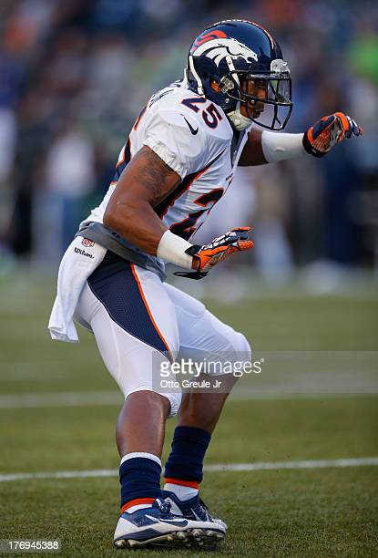 Cornerback Chris Harris of the Denver Broncos warms up prior to the game against the Seattle Seahawks at CenturyLink Field on August 17 2013 in...