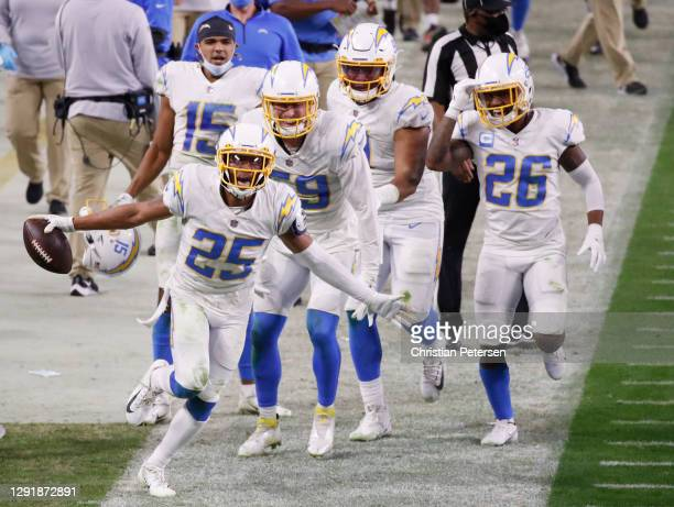 Cornerback Chris Harris of the Los Angeles Chargers reacts after intercepting the ball late in the second half against the Los Vegas Raiders at...