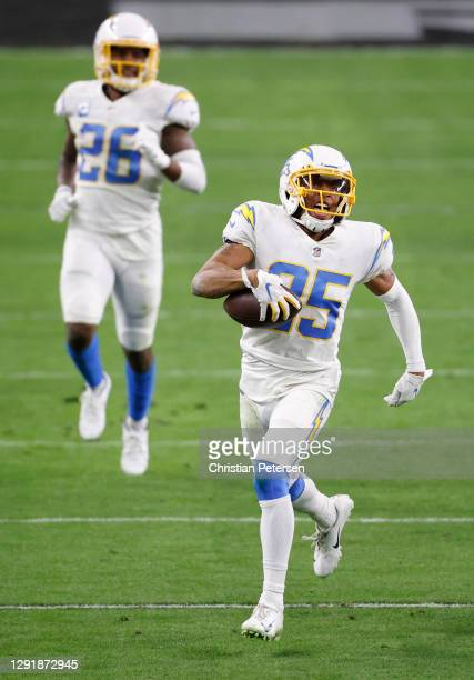 Cornerback Chris Harris of the Los Angeles Chargers runs the ball after making an interception late in the second half against the Los Vegas Raiders...