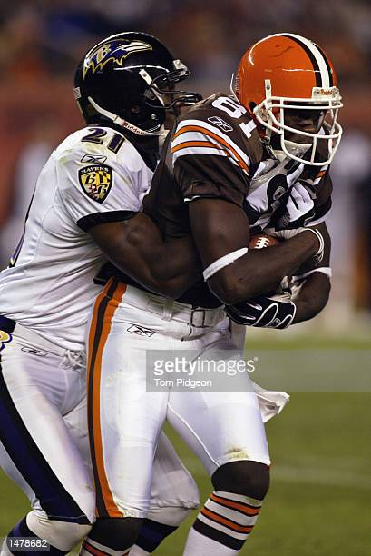 Cornerback Chris McAlister of the Baltimore Ravens tackles wide receiver Quincy Morgan of the Cleveland Browns during the NFL game on October 6 2002...
