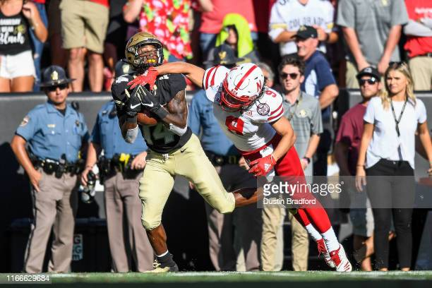 Cornerback Chris Miller of the Colorado Buffaloes intercepts a pass intended for wide receiver Kanawai Noa of the Nebraska Cornhuskers in the fourth...