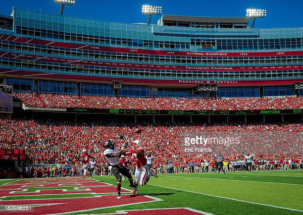 Cornerback Ciante Evans of the Nebraska Cornhuskers breaks up a pass intended for wide receiver Carlos McCants of the Arkansas State Red Wolves...