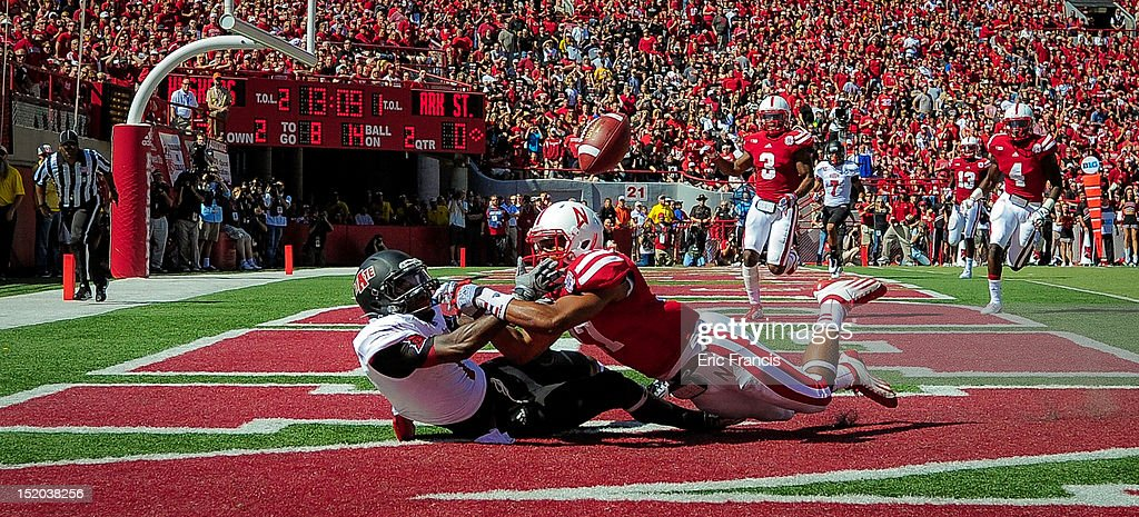 Cornerback Ciante Evans #17 of the Nebraska Cornhuskers breaks up a pass intended for wide receiver Carlos McCants #1 of the Arkansas State Red Wolves during their game at Memorial Stadium on September 15, 2012 in Lincoln, Nebraska.
