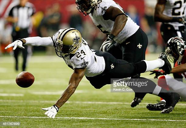 Cornerback Corey White of the New Orleans Saints recovers a fumble by wide receiver Darius Johnson of the Atlanta Falcons during a game at the...