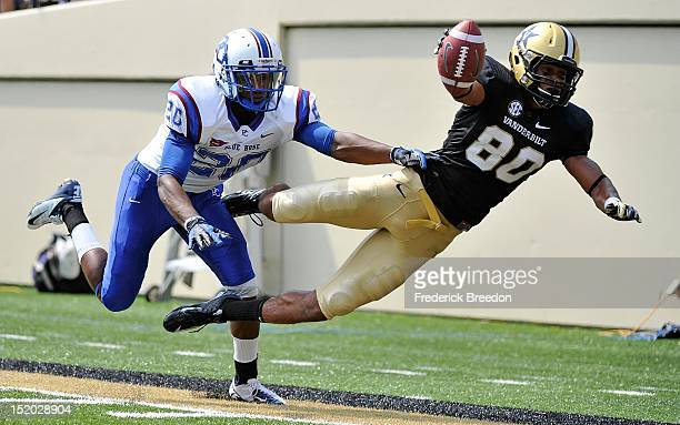 Cornerback Cory White of the Presbyterian Blue Hose watches wide receiver Chris Boyd of the Vanderbilt Commodores dive short of the end zone at...