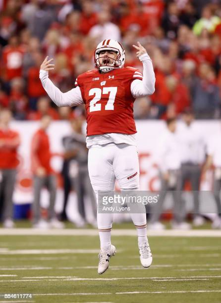 Cornerback Cristian Volpentesta of the Wisconsin Badgers reacts against the Ohio State Buckeyes in the second half during the Big Ten Championship...