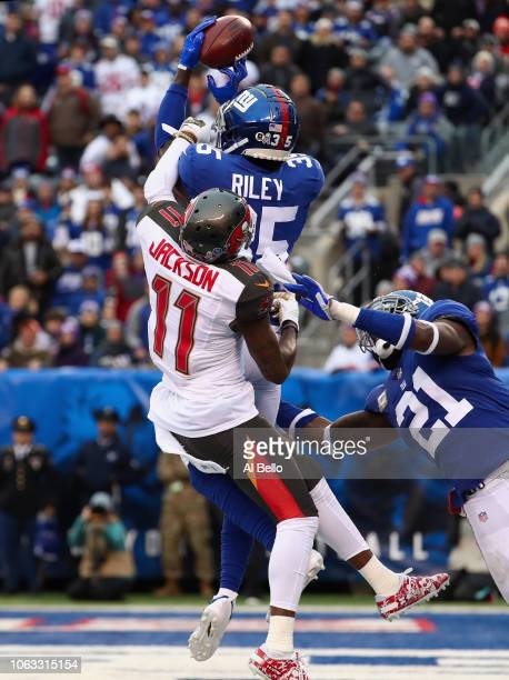 Cornerback Curtis Riley of the New York Giants makes an interception in the endzone against wide receiver DeSean Jackson of the Tampa Bay Buccaneers...