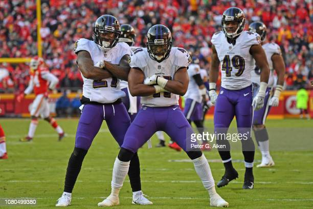 Cornerback Cyrus Jones and defensive back Anthony Levine of the Baltimore Ravens pose after a kickoff return during the second half against the...