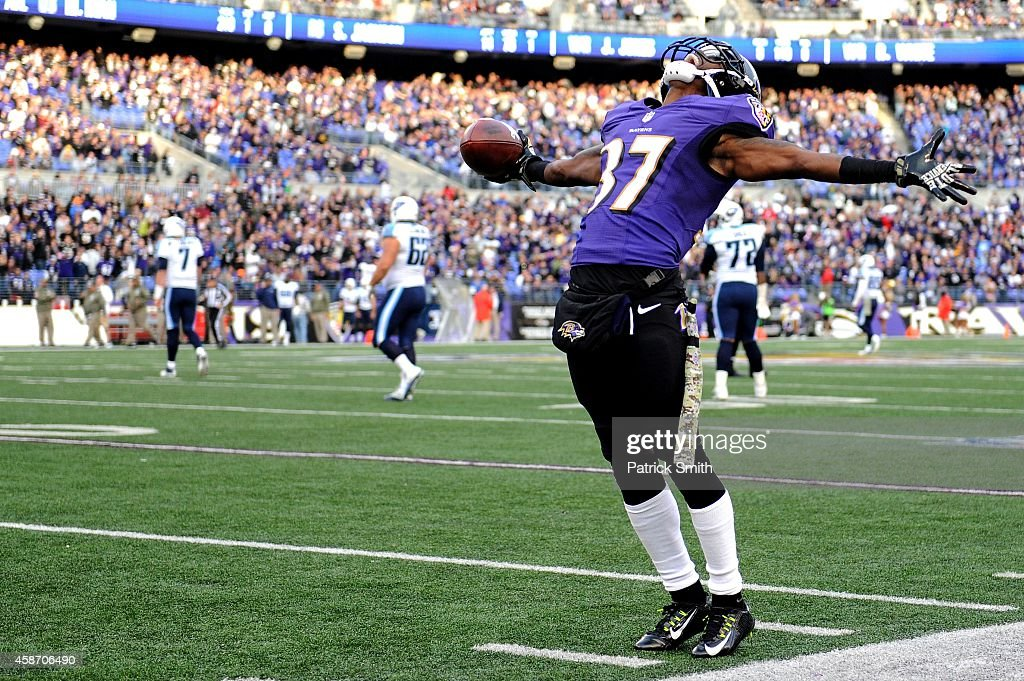 Cornerback Danny Gorrer #37 of the Baltimore Ravens celebrates an interception against the Tennessee Titans in the fourth quarter at M&T Bank Stadium on November 9, 2014 in Baltimore, Maryland.