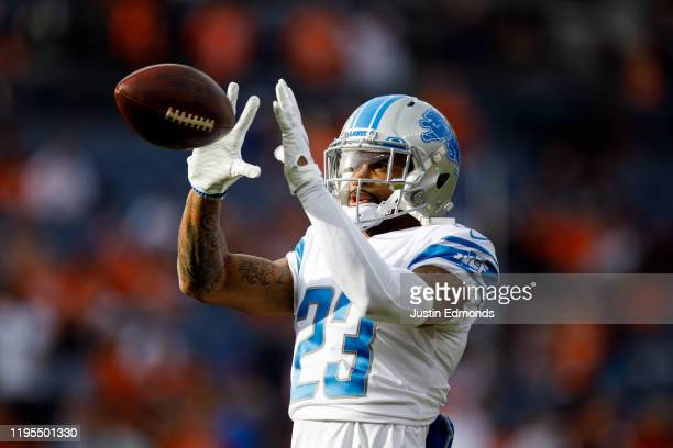 Cornerback Darius Slay of the Detroit Lions catches a pass during warm ups before a game against the Denver Broncos at Empower Field at Mile High on...