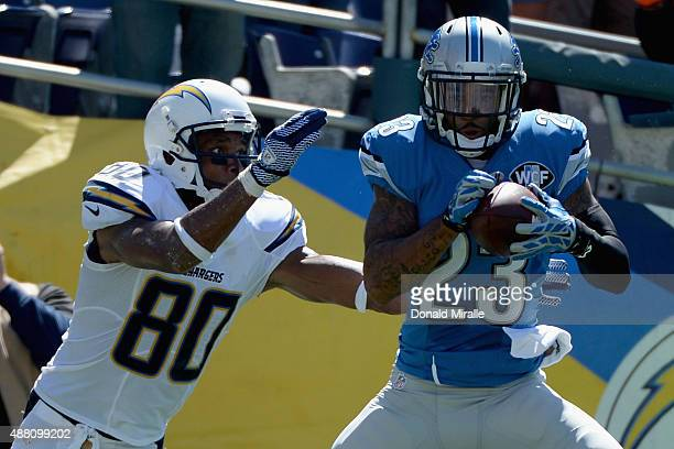 Cornerback Darius Slay of the Detroit Lions intercepts a pass intended for wide receiver Malcom Floyd of the San Diego Chargers in the end zone at...