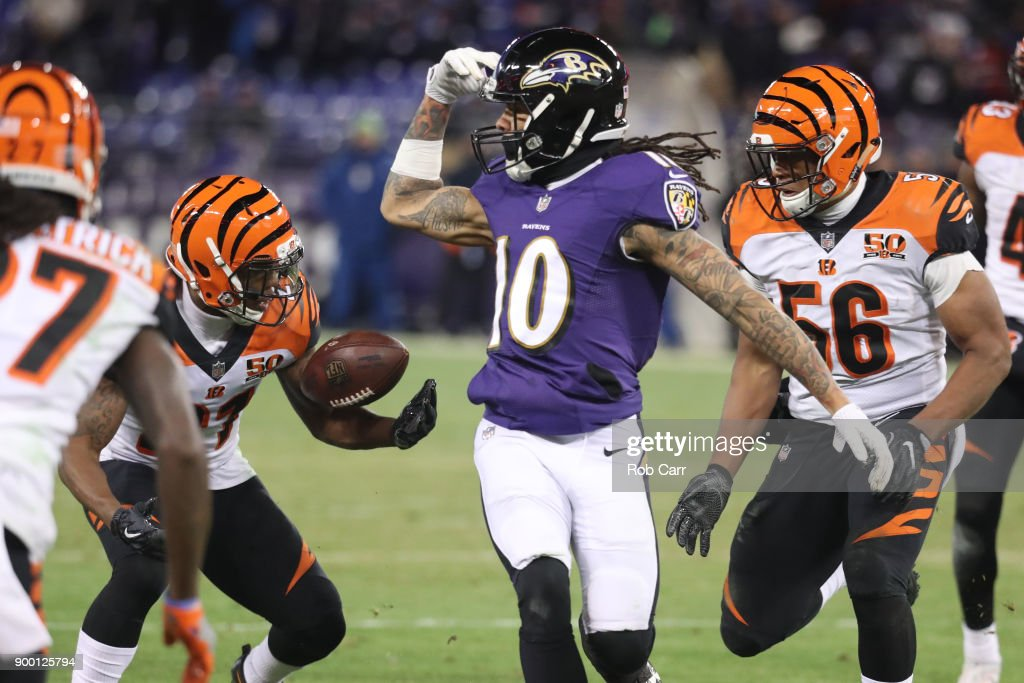 Cornerback Darqueze Dennard #21 of the Cincinnati Bengals intercepts a pass in the third quarter against the Baltimore Ravens at M&T Bank Stadium on December 31, 2017 in Baltimore, Maryland.