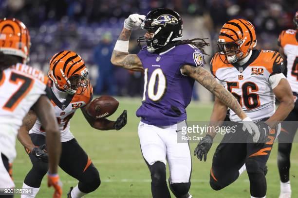 Cornerback Darqueze Dennard of the Cincinnati Bengals intercepts a pass in the third quarter against the Baltimore Ravens at MT Bank Stadium on...