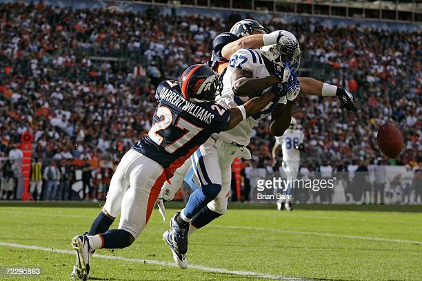 Cornerback Darrent Williams and safety John Lynch of the Denver Broncos break up a touchdown pass against wide receiver Reggie Wayne of the...