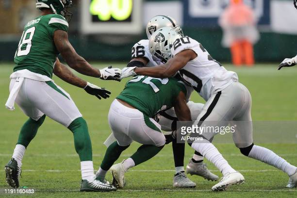 Cornerback Daryl Worley of the Oakland Raiders has a stop against the New York Jets in the first half in the rain at MetLife Stadium on November 24...