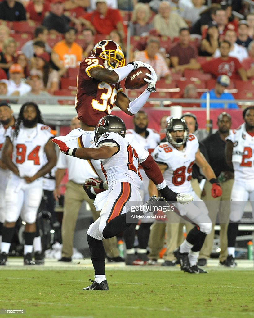 Cornerback David Amerson #39 of the Washington Redskins intercepts a pass in the second quarter against the Tampa Bay Buccaneers August 29, 2013 at Raymond James Stadium in Tampa, Florida.