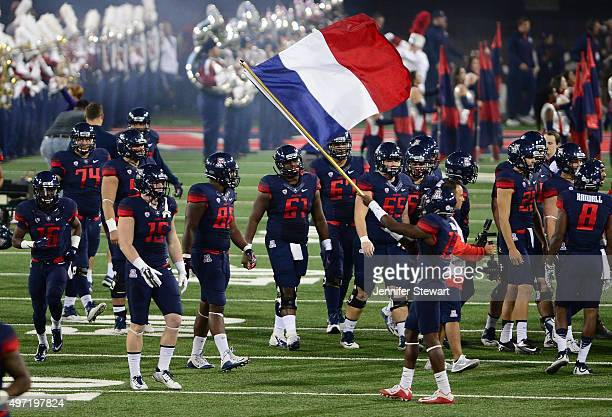 Cornerback DaVonte' Neal of the Arizona Wildcats waves the French flag prior to the game against the Utah Utes at Arizona Stadium on November 14 2015...