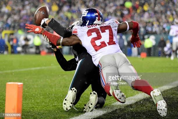 Cornerback Deandre Baker of the New York Giants breaks up a pass intended for wide receiver JJ ArcegaWhiteside of the Philadelphia Eagles during the...
