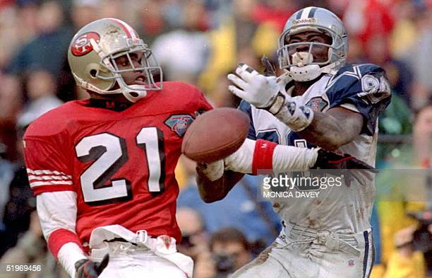 Cornerback Deion Sanders of the San Francisco 49ers breaks up a pass intended for Michael Irvin of the Dallas Cowboys during fourth quarter of their...