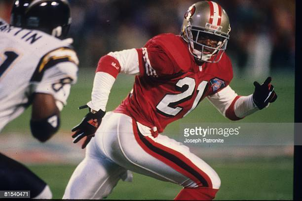 Cornerback Deion Sanders of the San Francisco 49ers covers wide receiver Tony Martin of the San Diego Chargers in Super Bowl XXIX at Joe Robbie...