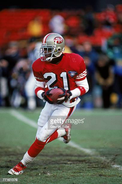 Cornerback Deion Sanders of the San Francisco 49ers runs with the ball during the 1993 NFC Championship game against the New York Giants at...