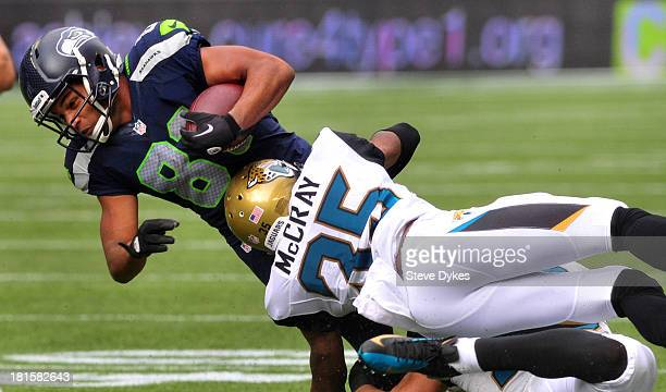 Cornerback Demetrius McCray of the Jacksonville Jaguars tackles wide receiver Golden Tate of the Seattle Seahawks during the second quarter of the...