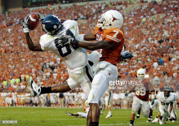 Cornerback Deon Beasley of the Texas Longhorns gets called for pass interference as wide receiver Jarett Dillard of the Rice Owls drops a pass in the...