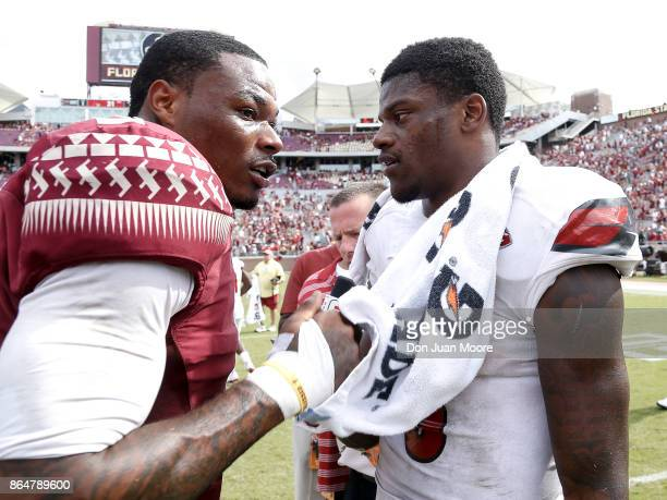 Cornerback Derwin James of the Florida State Seminoles talk with Quarterback Lamar Jackson of the Louisville Cardinals after the game at Doak...