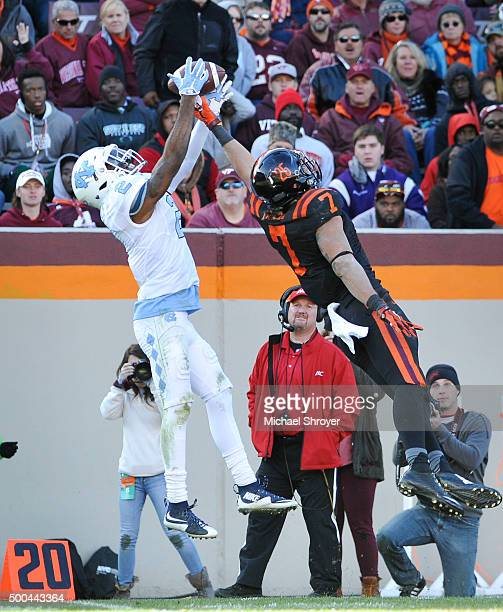 Cornerback Des Lawrence of the North Carolina Tar Heels intercepts a pass intended for tight end Bucky Hodges of the Virginia Tech Hokies in the...