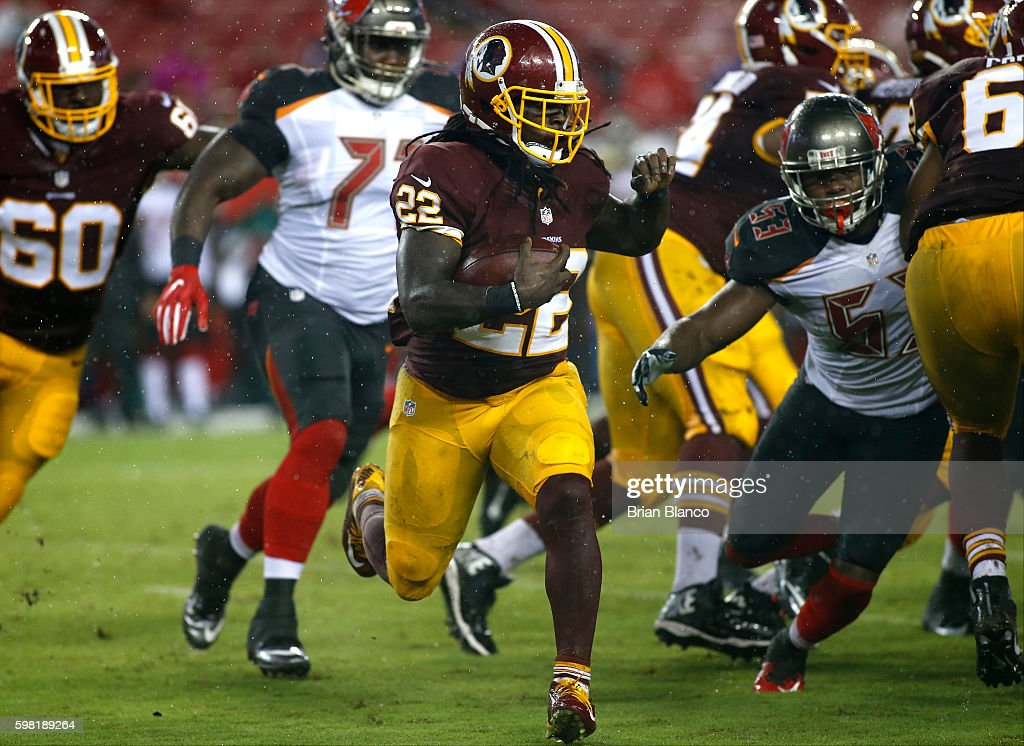 Cornerback Deshazor Everett #22 of the Washington Redskins runs for a first down during the third quarter of an NFL preseason game against the Tampa Bay Buccaneers on August 31, 2016 at Raymond James Stadium in Tampa, Florida.