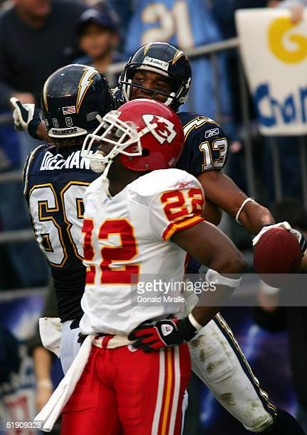 Cornerback Dexter McCleon of the Kansas City Chiefs stands dejected as wide receiver Malcom Floyd and guard Kris Dielman of the San Diego Chargers...