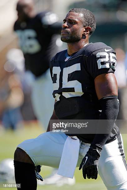 Cornerback DJ Hayden of the Oakland Raiders stretches before a game against the Jacksonville Jaguars on September 15, 2013 at O.co Coliseum in...