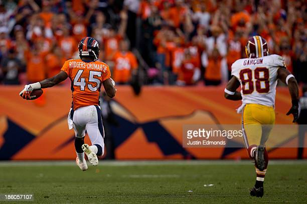 Cornerback Dominique RodgersCromartie of the Denver Broncos strides towards the end zone for a touchdown after making an interception on a pass...