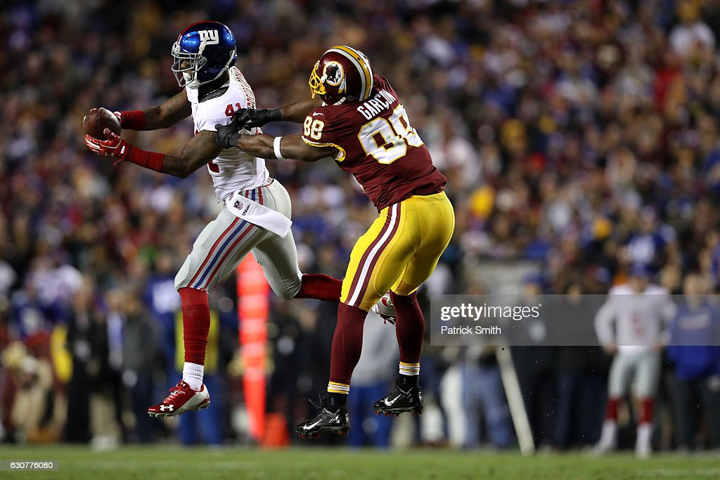 Cornerback Dominique Rodgers-Cromartie #41 of the New York Giants intercepts the ball in front of wide receiver Pierre Garcon #88 of the Washington Redskins in the fourth quarter at FedExField on January 1, 2017 in Landover, Maryland.