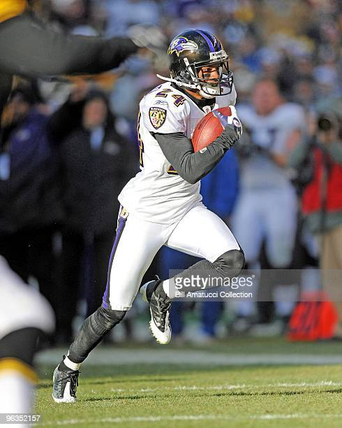 Cornerback Domonique Foxworth of the Baltimore Ravens returns an intercepted pass during a game on December 27, 2009 against the Pittsburgh Steelers...