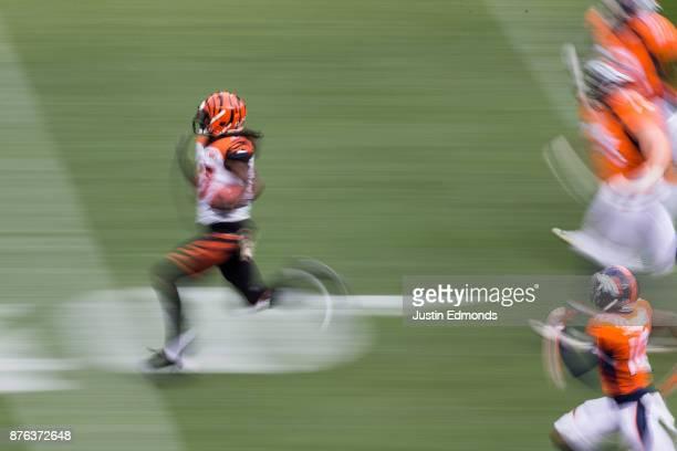 Cornerback Dre Kirkpatrick of the Cincinnati Bengals returns an interception for 87 yards against the Denver Broncos in the first quarter of a game...