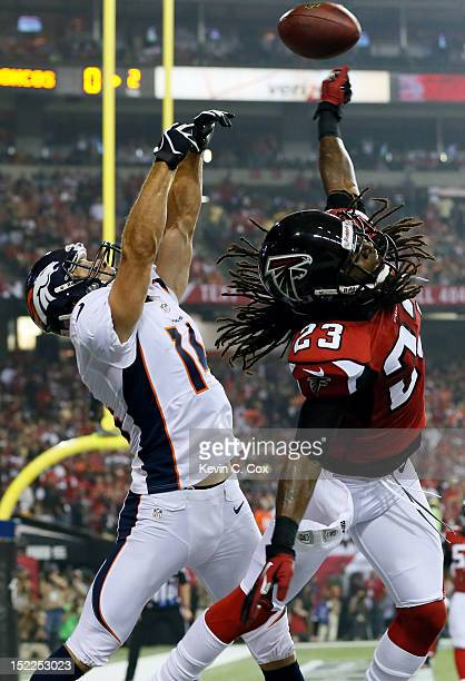 Cornerback Dunta Robinson of the Atlanta Falcons breaks up a pass intended for wide receiver Brandon Stokley of the Denver Broncos in the end zone...