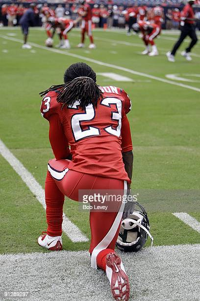 Cornerback Dunta Robinson of the Houston Texans watches from the sidelines during pre-game warmups before the game against the Jacksonville Jaguars...