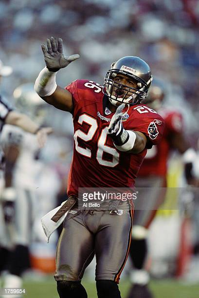 Cornerback Dwight Smith of the Tampa Bay Buccaneers celebrates a tackle against the Oakland Raiders during Super Bowl XXXVII at Qualcomm Stadium on...