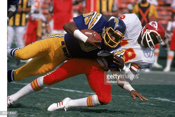 Cornerback Emmitt Thomas of the Kansas City Chiefs tackles wide receiver Dwight McDonald of the San Diego Chargers at San Diego Stadium on October 27...