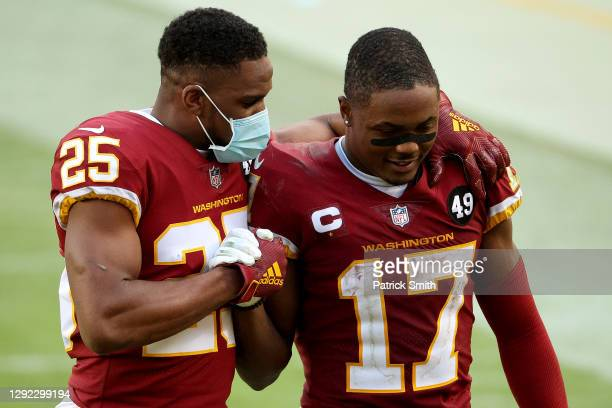 Cornerback Fabian Moreau and wide receiver Terry McLaurin of the Washington Football Team walk off the field following their 20-15 loss to the...