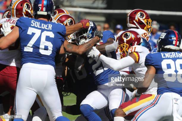 Cornerback Fabian Moreau of the Washington Redskins makes a stop against the New York Giants in the first half at MetLife Stadium on September 29,...