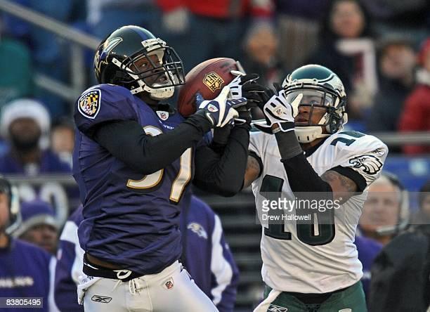 Cornerback Fabian Washington of the Baltimore Ravens intercepts a pass over wide receiver DeSean Jackson of the Philadelphia Eagles on November 23,...