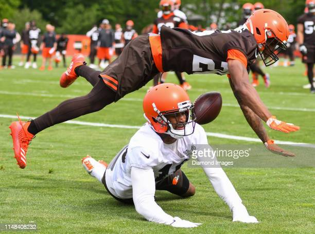 cornerback Greedy Williams of the Cleveland Browns breaks up a pass against wide receiver Jaelen Strong during a mandatory mini camp practice on June...