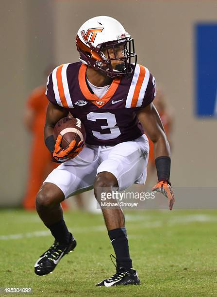 Cornerback Greg Stroman of the Virginia Tech Hokies returns a punt against the North Carolina State Wolfpack in the first half on October 9 2015 in...